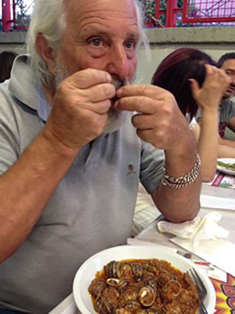 Pino uses a toothpick to pluck out the juicy snails