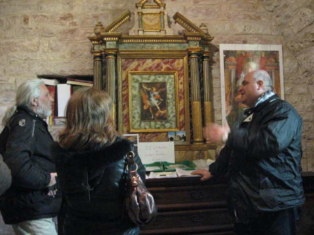 "The ""keeper of the keys"" shows visitors the venerated Madonna image"