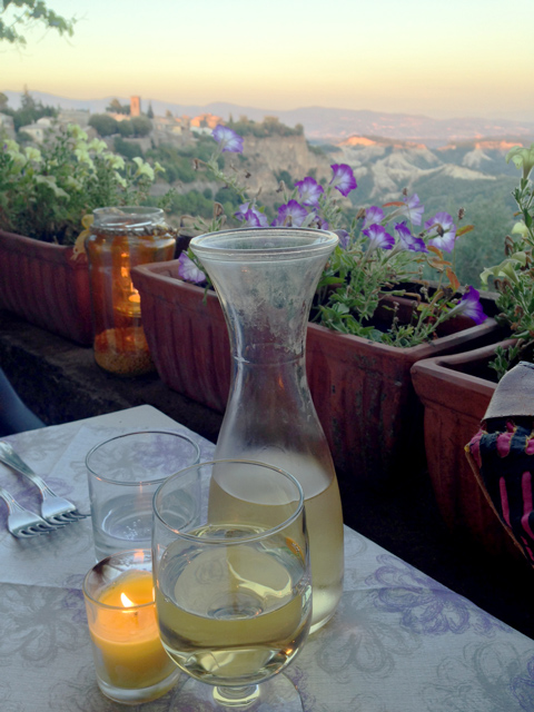 It might seem that the sip of white wine and the landscape splendor is enough….