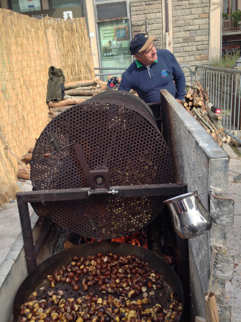 Chestnuts whirl on huge rotating bins manned by arcidossini