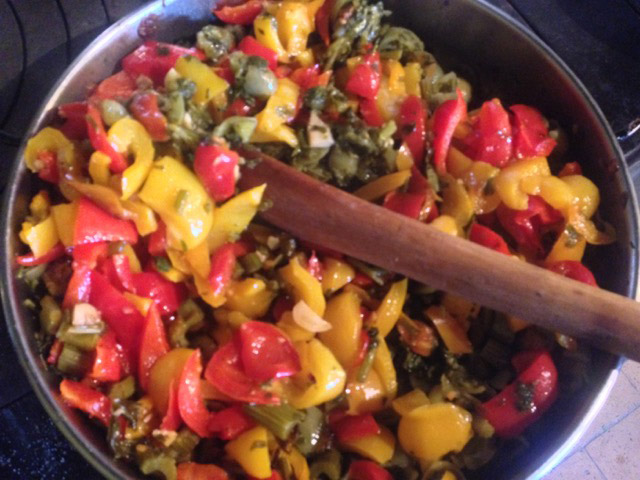 Peppers simmer with diced celery