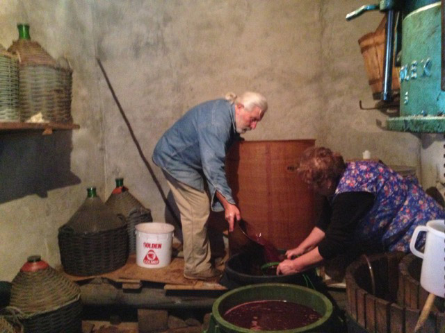 Pino and Peppa try to save the wine, passing it through a copper sieve