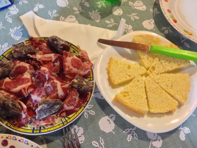 Antipasto of homemade cheesebread and homemade capocollo