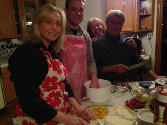 Donna with her guests, at work in the kitchen