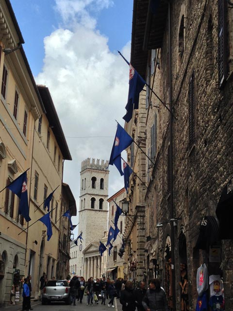 Blue flags flutter over Upper Assisi la Parte de Sopra streets