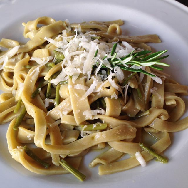 Homemade tagliatelle with wild asparagus from the woods