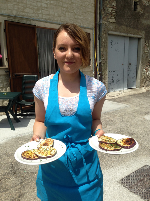 Claire serves grilled eggplant