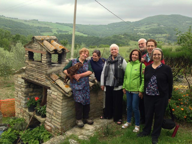 Peppa with our group at her outdoor wood bread oven
