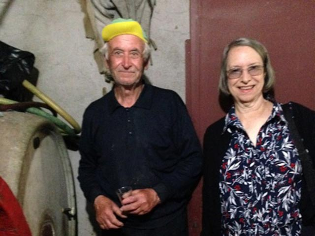 Sally with Peppe in his wine cellar