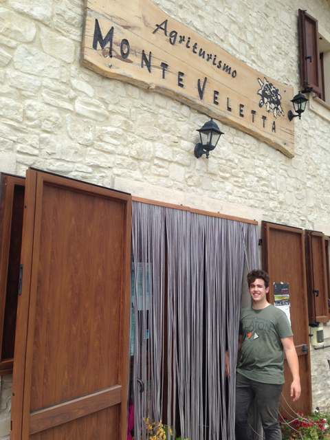 Davide at the door of his family's restaurant
