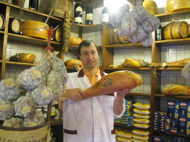 emiliano-proudly-shows-the-prosciutto-they-produce