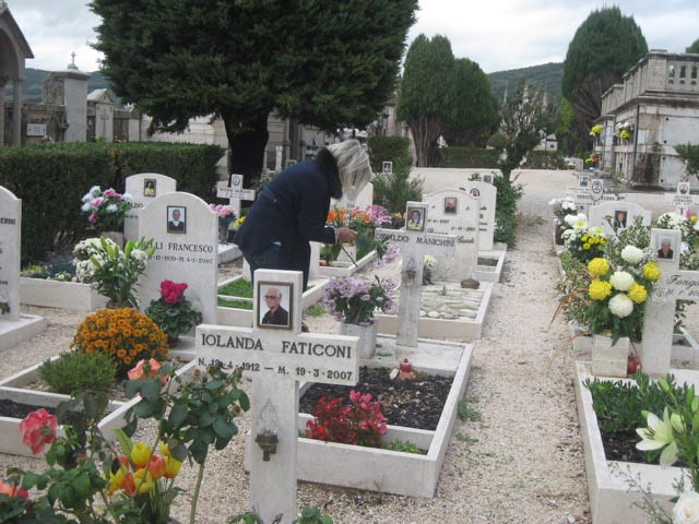 relatives-visit-their-deceased-cleaning-the-tombs-putting-fresh-flowers