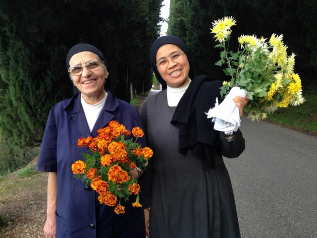 sisters-on-their-way-to-the-cemetery-to-the-graves-of-their-deceased-nuns