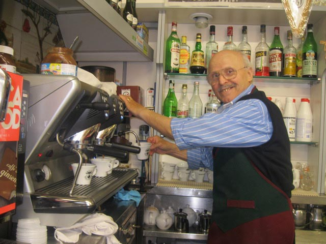 Umberto-grins-at-his-cappuccino-machine